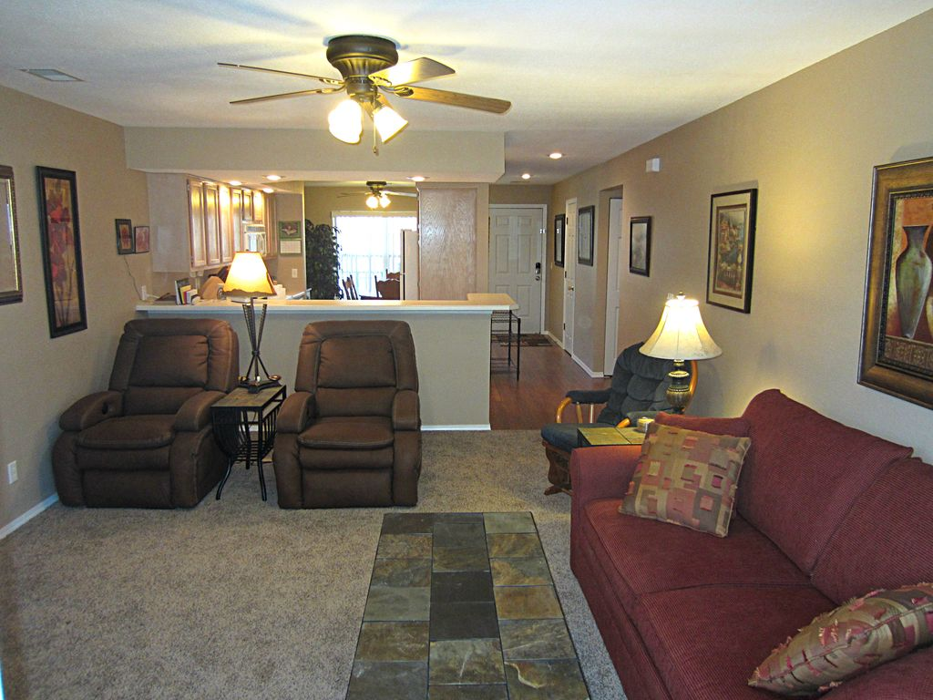 The living room walks out to your screened porch. Electric fireplace. Seats 6.