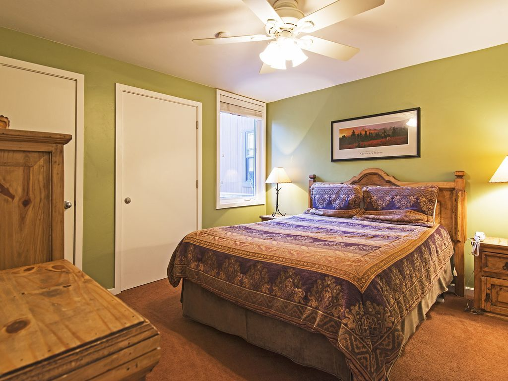 master bedroom with queen size bed and ensuite bathroom
