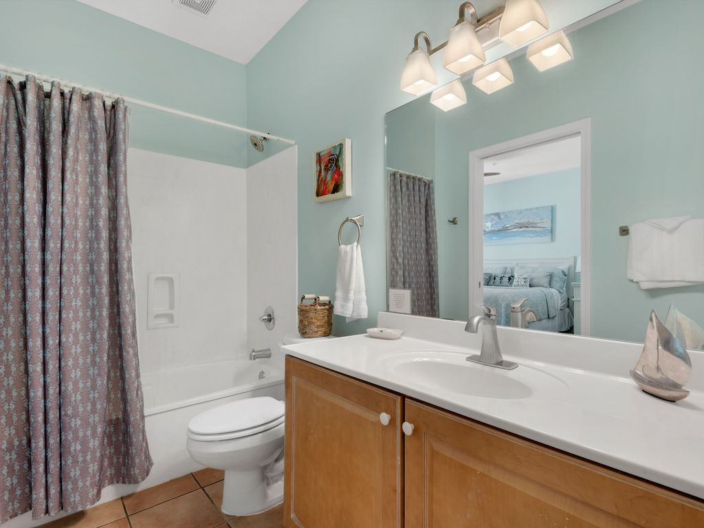Beautiful new lighting and faucet fixtures, with hallway and bedroom access