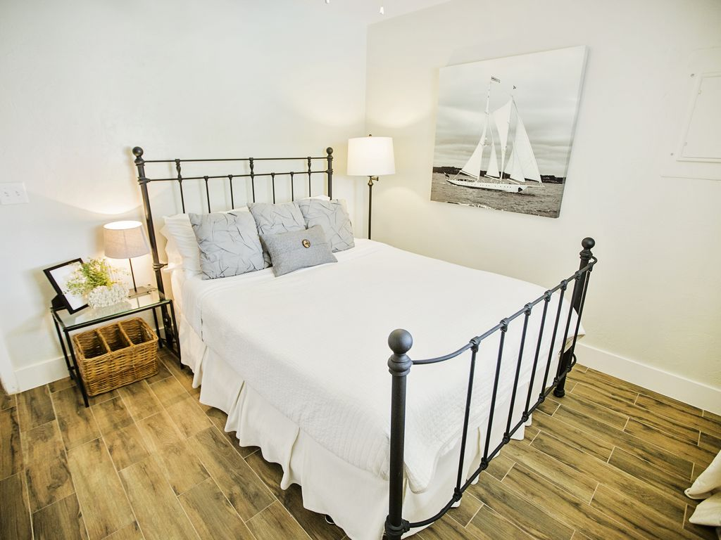 Our costal style guest bedroom with a rod iron bed has a comfortable queen bed.