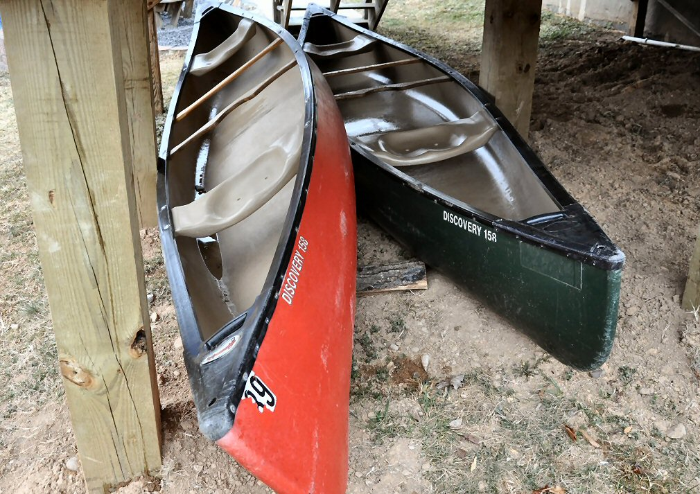 2 large canoes w/ oars and life jackets