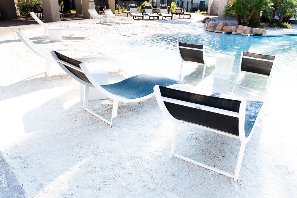 Lounge chairs at the sand entry pool