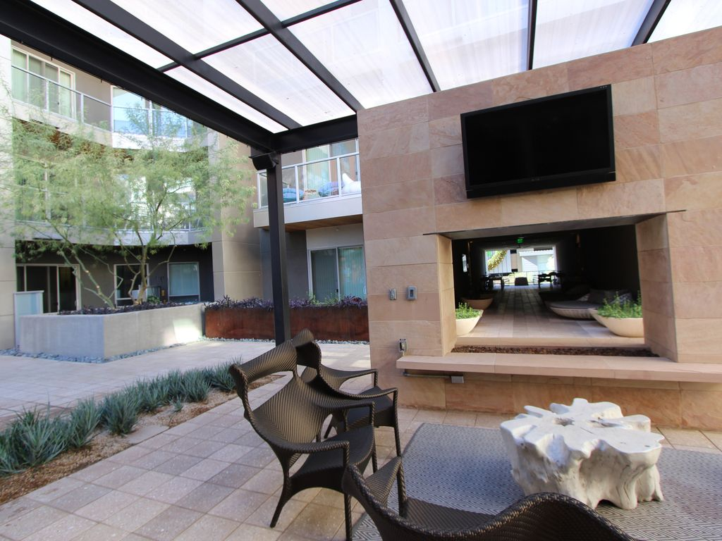 View of outdoor fireplace from your patio.