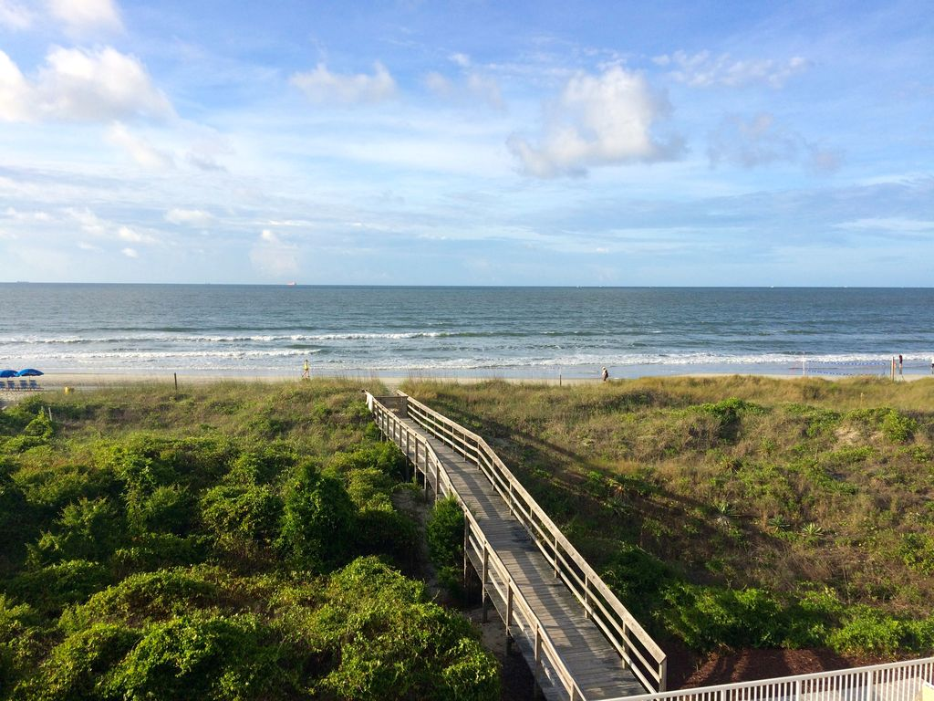 The beach is steps away from the condo!!