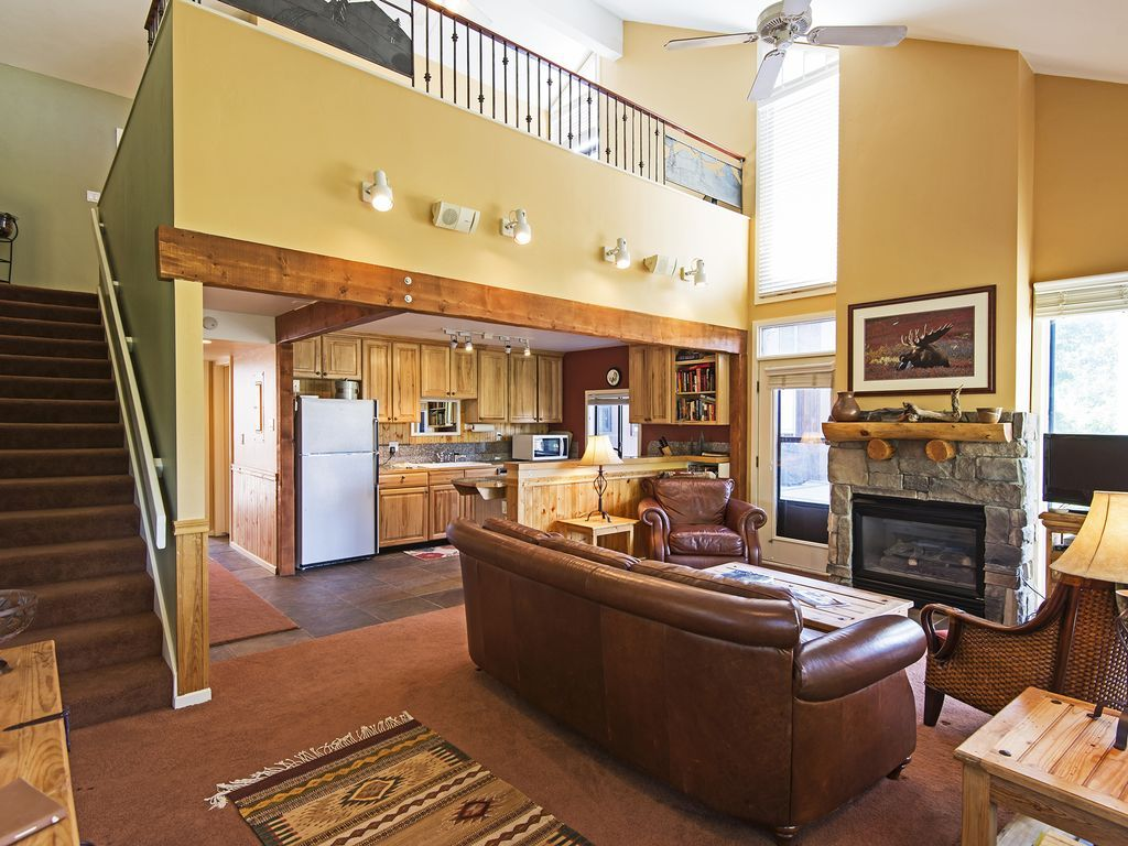 Living area, kitchen and stairs to upper level