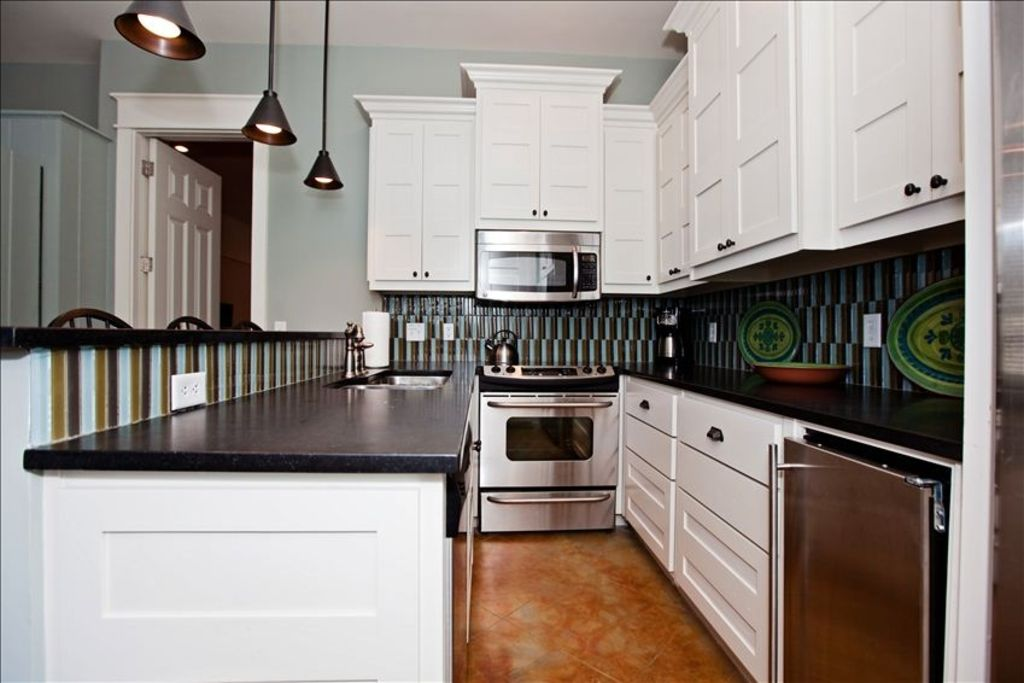 Downstairs suite, 2nd kitchen full stainless/granite. Also large ice maker.
