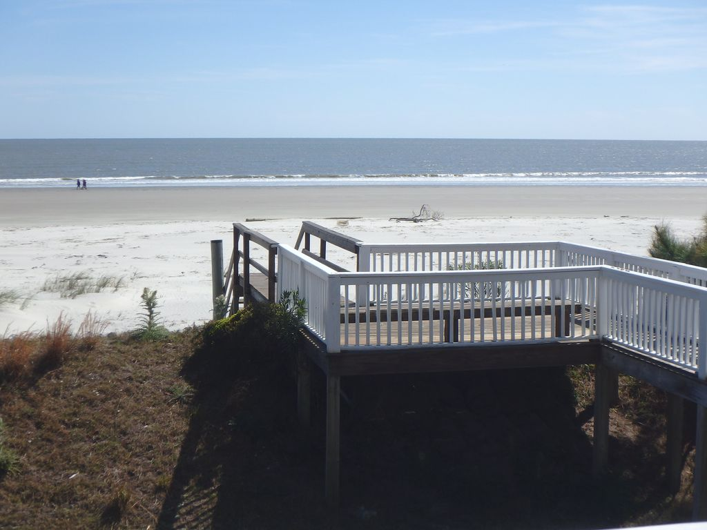 View of private beach and private beach access from deck of home