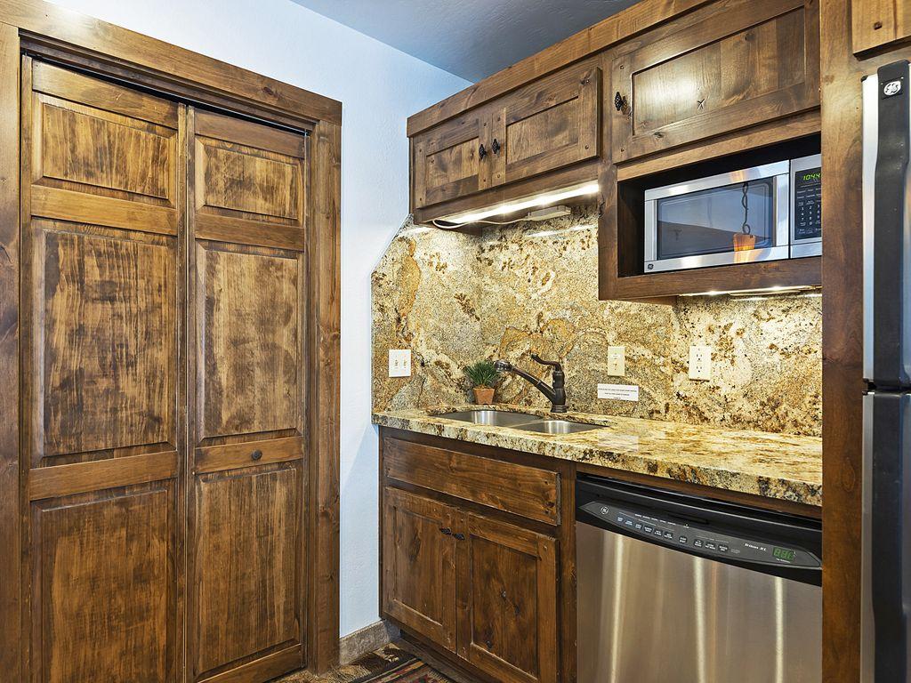 Kitchen area - (washer/dryer behind closet doors)