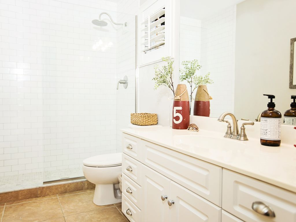 Guest bathroom with a newly remodeled walk in rainfall shower