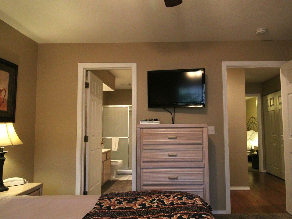 The guest bedroom has 2 doors. The bathroom also has a door to the hall.