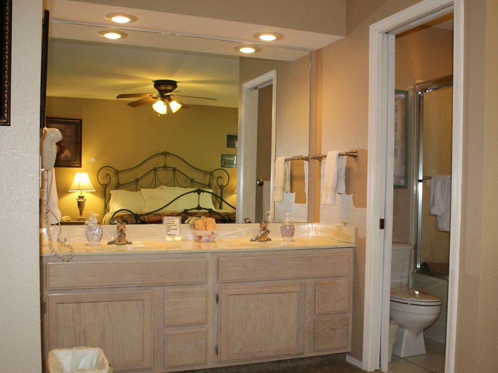 The master bedroom has dual vanity sinks in the bedroom.