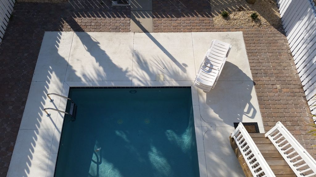 Pool viewed from main level porch