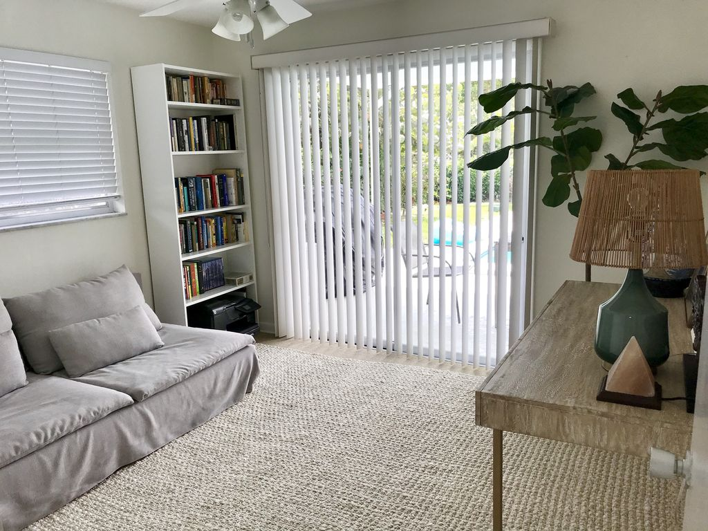 Office room with sofa that is perfect for a toddler bed