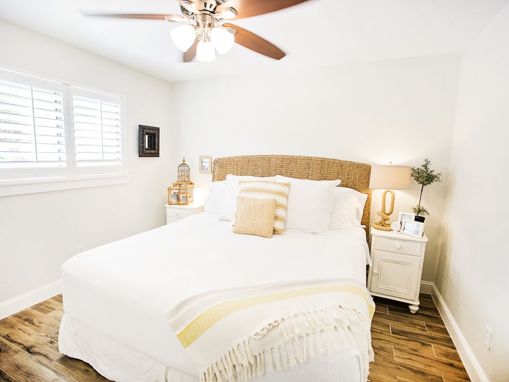Costal style guest bedroom with seagrass accents and cottage style furniture