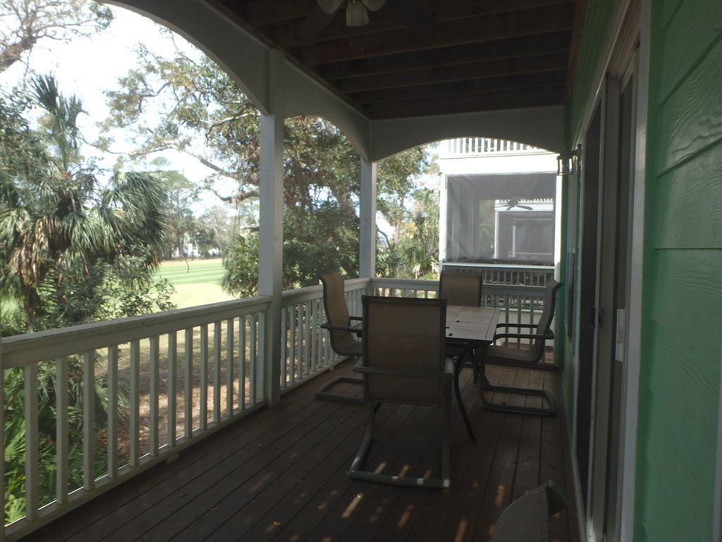Screen porch overlooking golf course