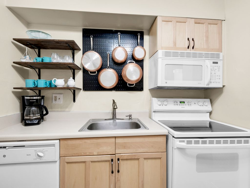 Fully-stocked kitchen with electric stove