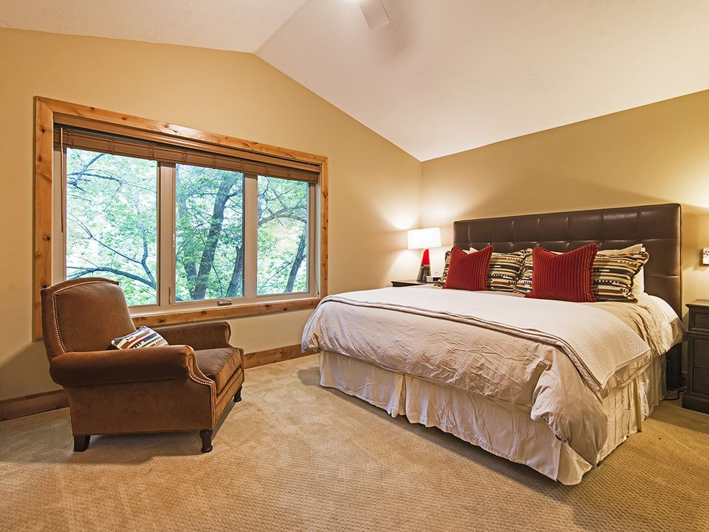 Master bedroom.  King bed, flat screen TV, views of library park