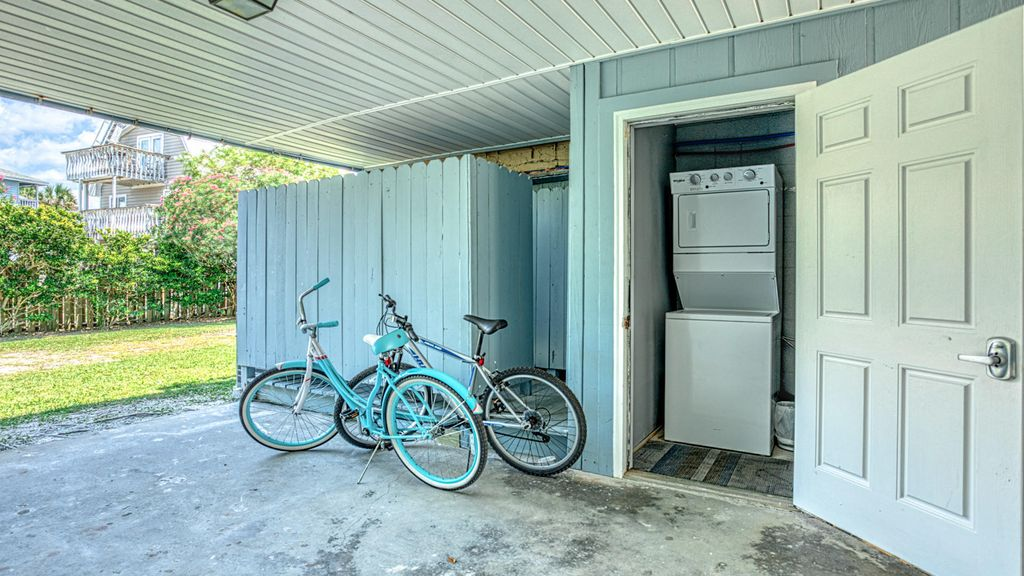1st floor - Laundry room and storage area and outdoor showering station!