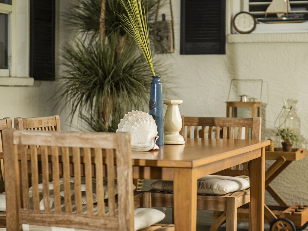 Teak dining furniture invite you to spend time outside...