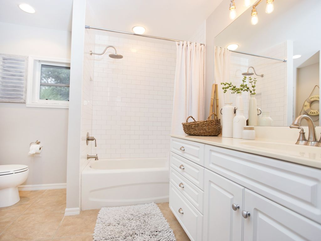 Master bathroom with subway tile, rainfall shower and Edison bulbs...