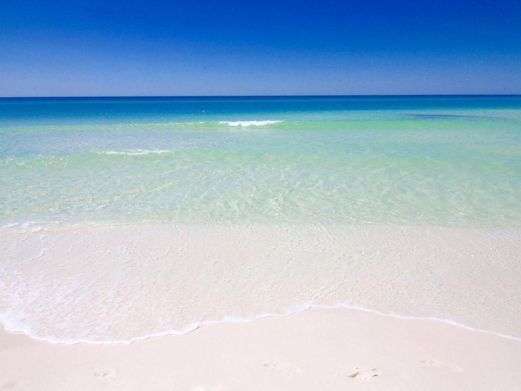 Emerald waters and sugar white sands just steps away from our luxury condo unit