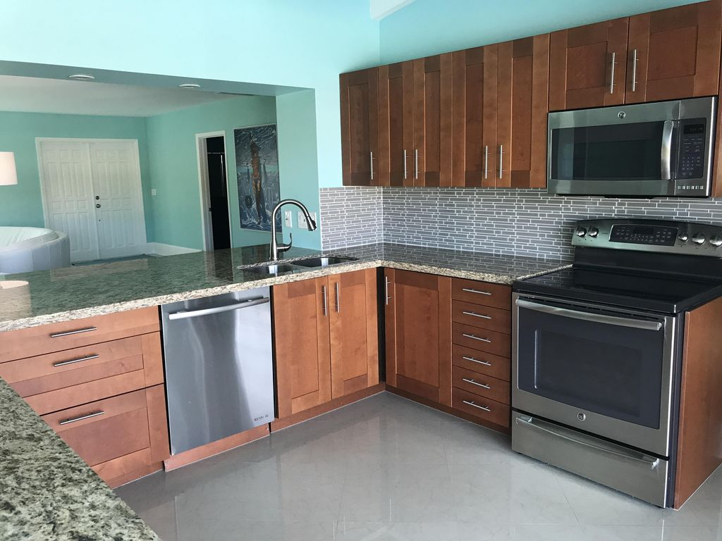Kitchen.  Great kitchen space with 4 electric burners, oven, huge refrigerator