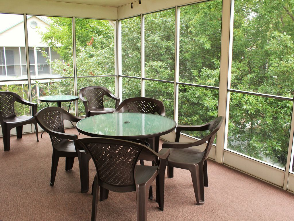The screened porch offers you a view of the hidden garden & gazebo. Seats 8.