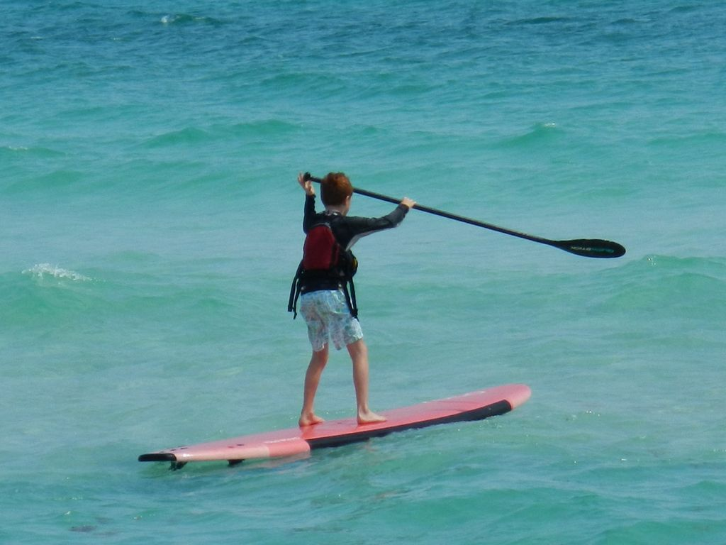 Here comes Nolan on a paddle board, going down to Rosemary beach for a treat!