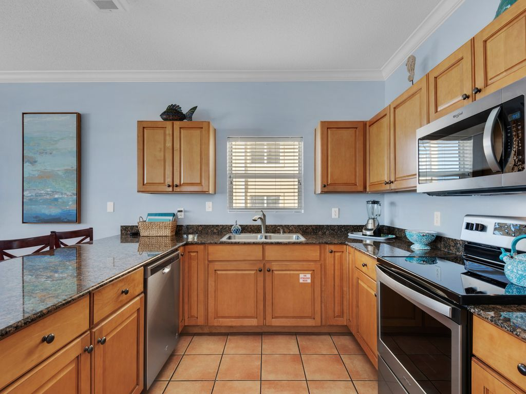 ALL NEW stainless-steel appliances!  Roomy kitchen filled with natural sunlight!