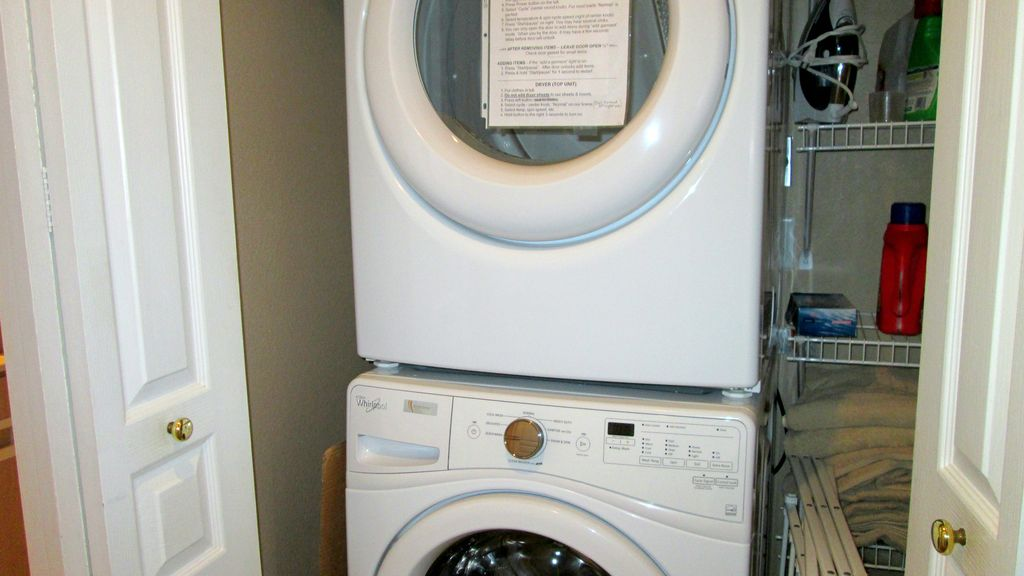 Your laundry center is located in the condo. Ironing board, iron,  & drying rack