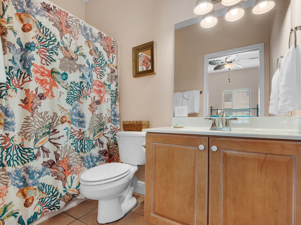 Ensuite full-sized bathroom has new faucets and lighting, with tub/shower