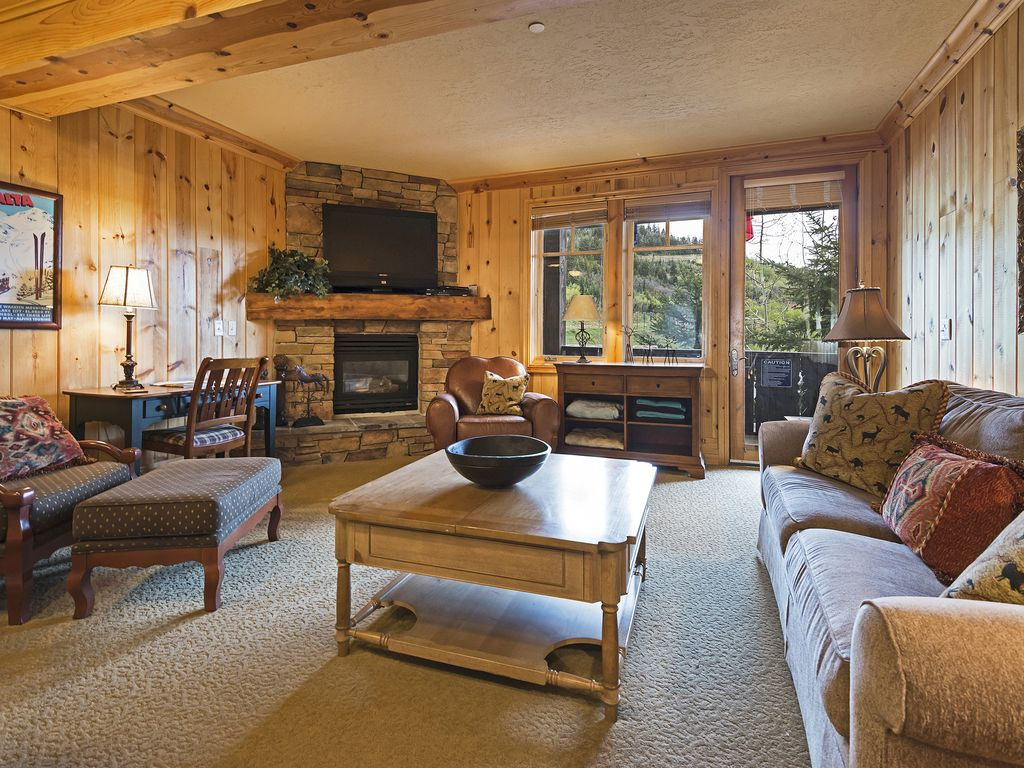 Living area, fireplace, hot tub on private deck