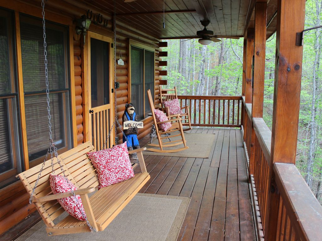 Spend a quite afternoon swinging or rocking on the covered front porch