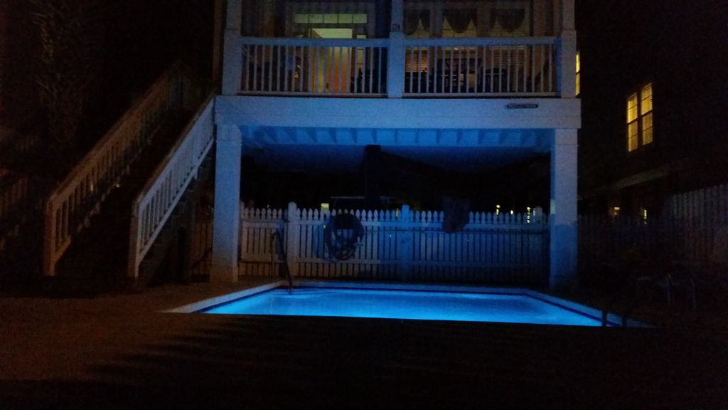 Pool at night- has multiple light colors