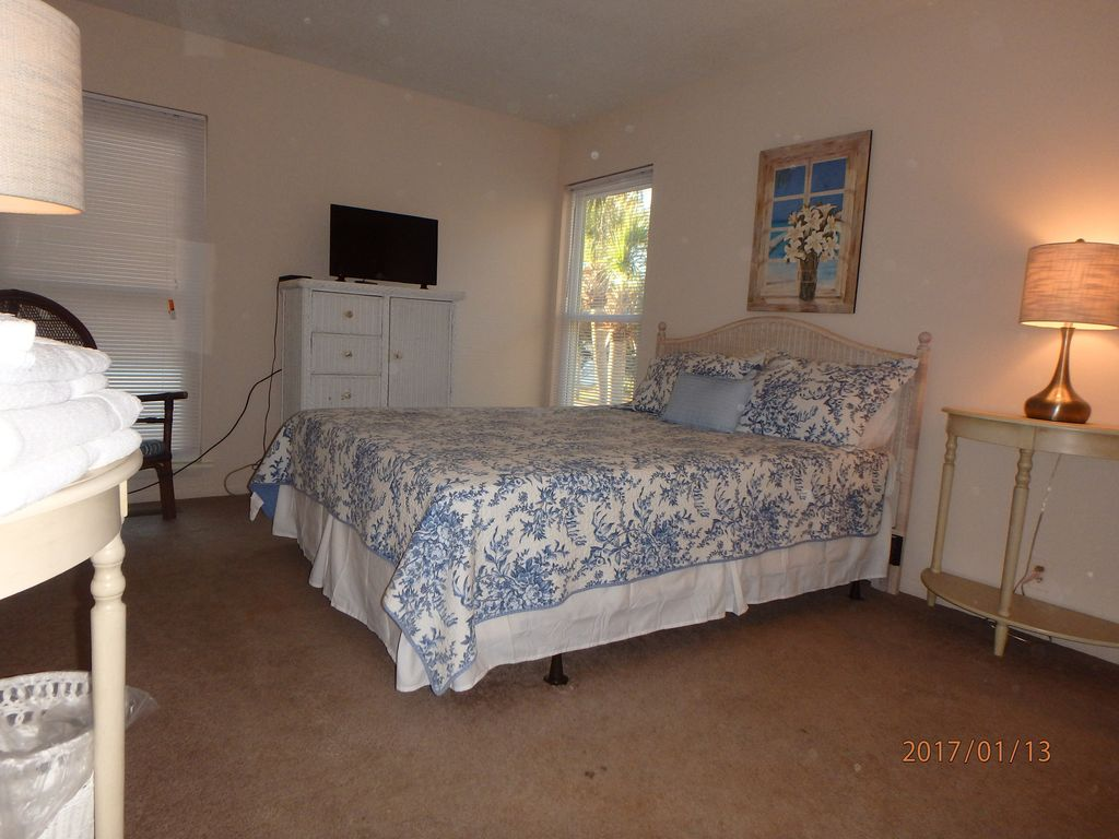 One of two 1st floor guest rooms with queen bed and ocean view