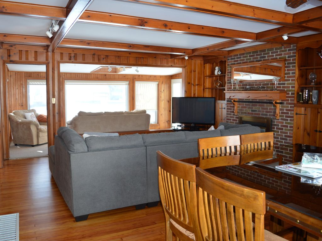 Dine, relax or sit in the sun room and take in the wooden features