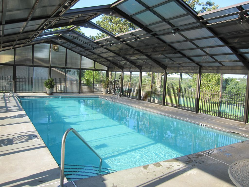 The indoor pool is 4 to 5 foot deep. Only 1 block from your condo.