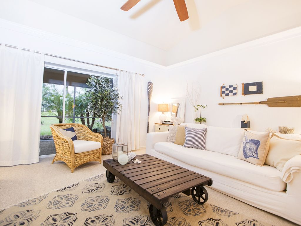 Turn on our oversize ceiling fan to get a little summer breeze inside