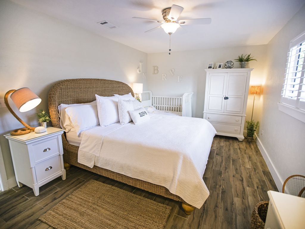 Relax in the spacious master bedroom with seagrass accents.