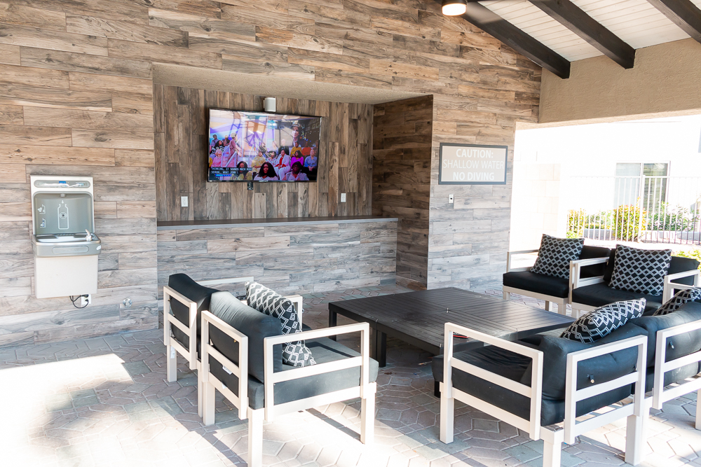 BBQ area with flatscreen TV at the pool.