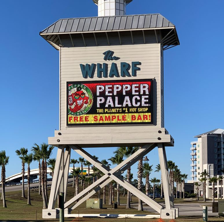 The Wharf at Orange Beach, includes AMC, Ferris wheel, marina, stores, zip line