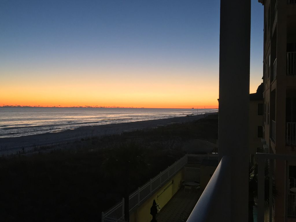 Watch the sun drop below the horizon from the comfort of your private balcony