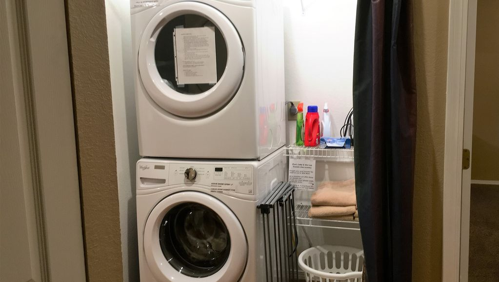 A washer & dryer are in the condo.