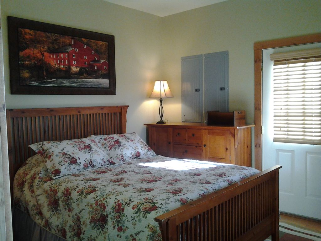 Lower level Queen Bedroom - Access to outdoor middle level parking/ garage area