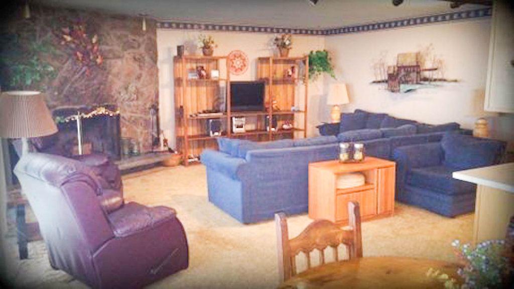 Cozy, comfortable seating & wood burning fireplace
