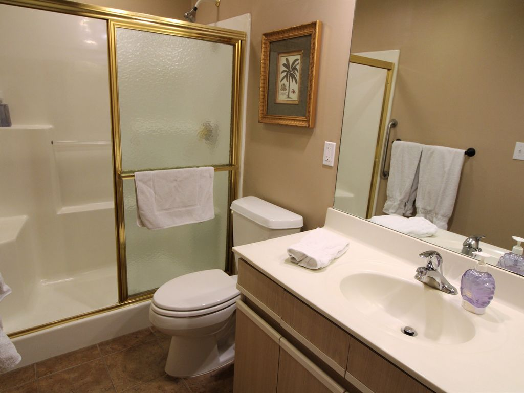 Shower stall in the guest bath.  Doors to both hall and guest bedroom.