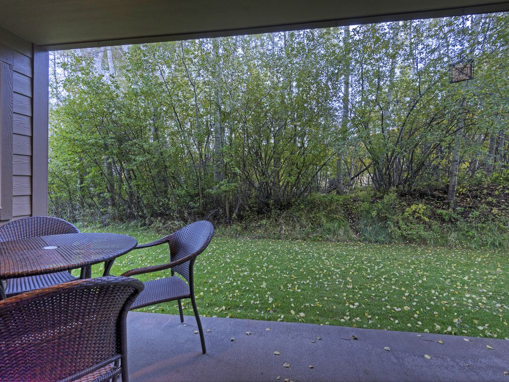 outside deck off living area.  PC Resort through trees!