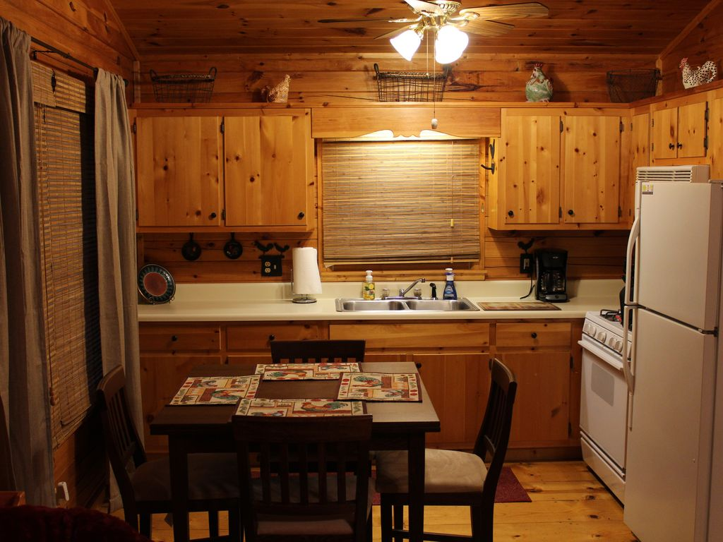 Kitchen comes stocked with cooking ware, plates, glasses, utensils and some cooking supplies