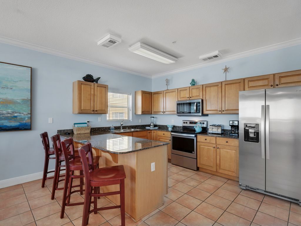 Large kitchen-NEW stainless steel appliances. Filled with natural sunlight.