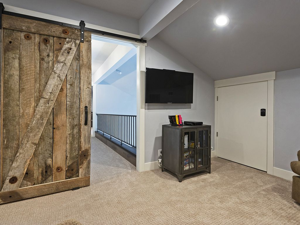 Upstairs hang out area.  Shuts off to downstairs with barn door